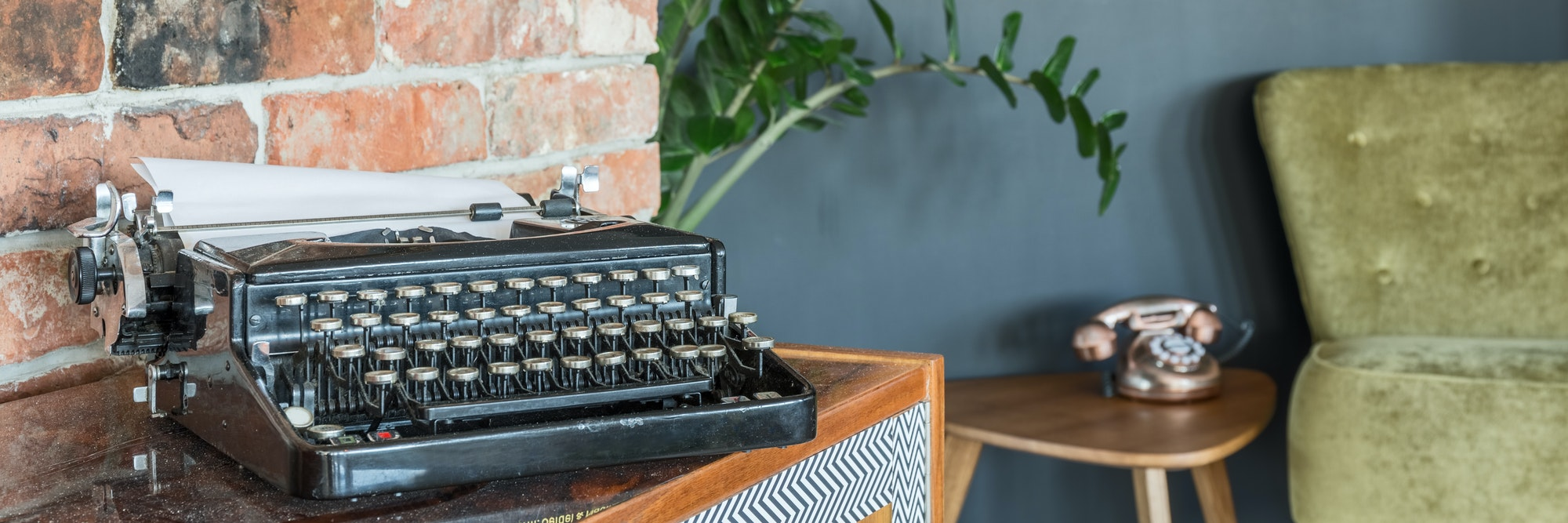 Antique typewriter and armchair